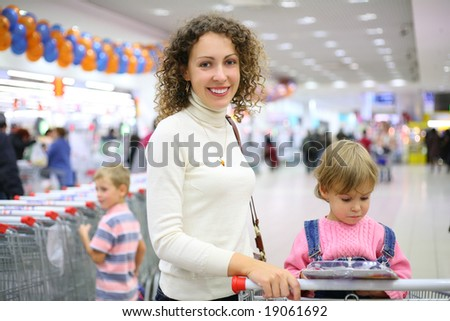 mother with children in shop - stock photo