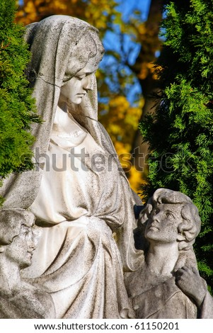 Mother with children-old tombstone on Central Cemetery in Vienna,Austria.