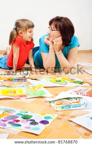 Mother with children painted on the floor. - stock photo