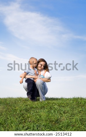 Mother with childrens. Sky. Grass. 3 - stock photo