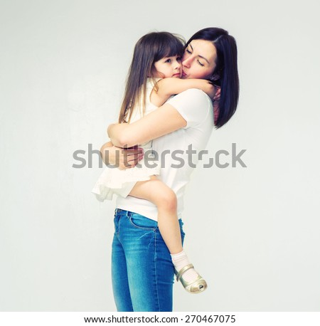 Mother with cute daughter portrait keep baby on hands family studio on white  - stock photo