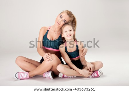 Mother with daughter. Fit. Studio shot. Gymnastic.