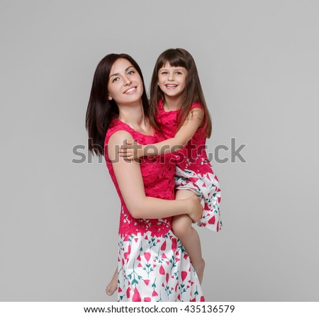 Mother with daughter happy together portrait child, family - stock photo