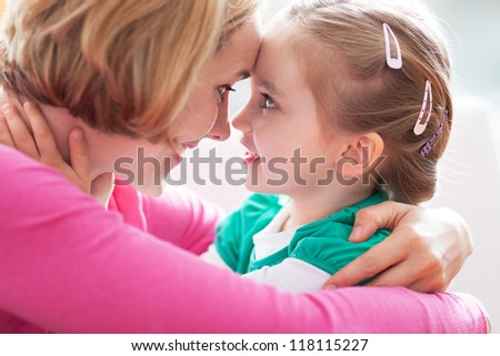 Mother with daughter hugging