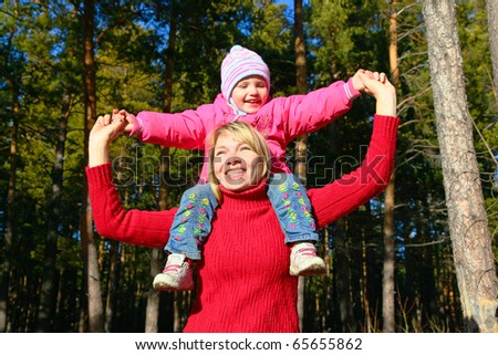 mother with daughter in forest - stock photo