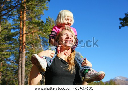 mother with daughter in forest of pine - stock photo