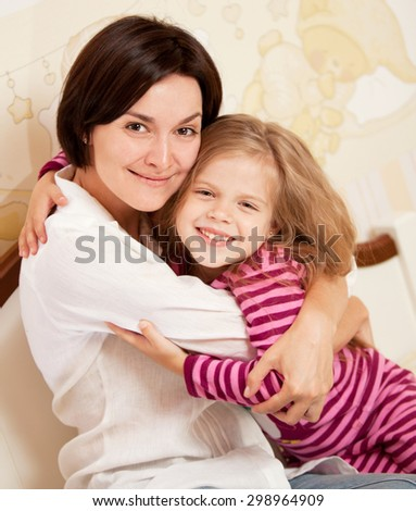 mother with daughter on the bed