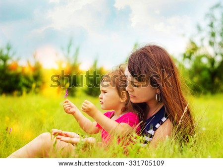 mother with daughter on the nature - stock photo