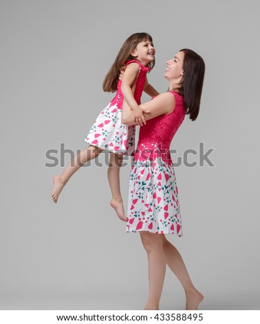 Mother with daughter portrait child, family - stock photo