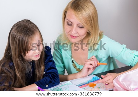 mother with daughter studying together