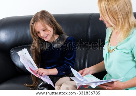 mother with daughter studying together - stock photo