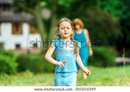 Mother with daughter walking in a village, peace and calm - stock photo
