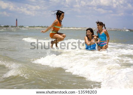 Mother with daughters having fun at the ocean