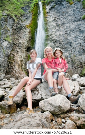 Mother with daughters on mountain trek
