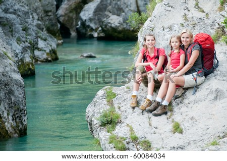 Mother with daughters on mountain trek - stock photo