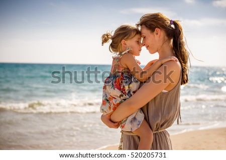 mother with girl on the coast