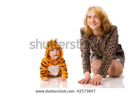 Mother with half year daughter baby wearing tiger costume isolated - stock photo