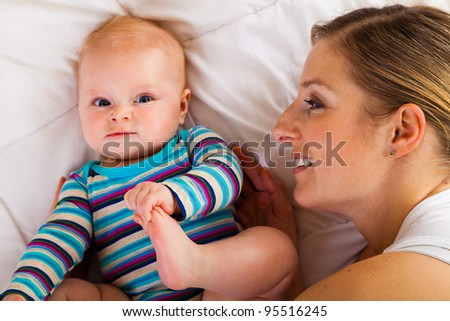 Mother with happy and cute infant baby girl - stock photo