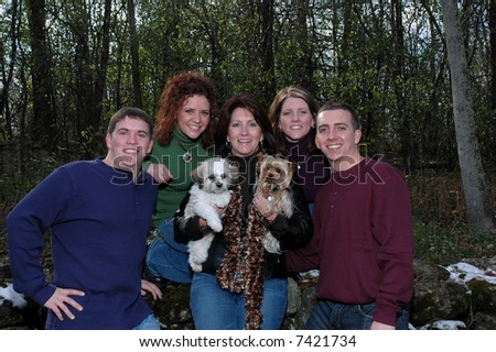 mother with her adult children and dogs - stock photo
