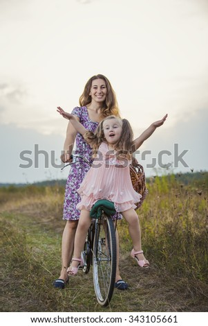 mother with her baby and a bike ride in nature