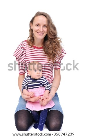 mother with her baby in her arms/happy mother with a charming baby in her arms - stock photo