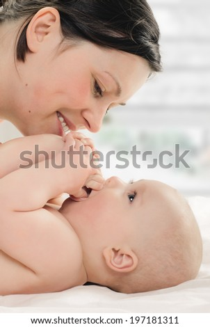 mother with her baby in the room with window background
