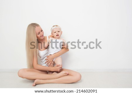 mother with her baby studio shot - stock photo