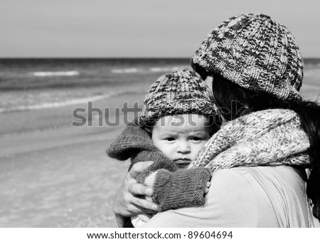 mother with her child on the beach - stock photo
