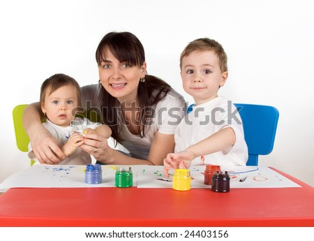Mother with her childern enjoy painting with assorted colours