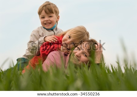 Mother with her children on the meadow