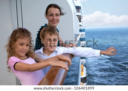 mother with her children travel on ship - stock photo