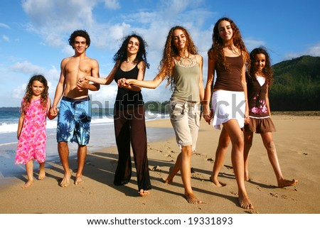 Mother With Her 5 Children Walking Along the Beach