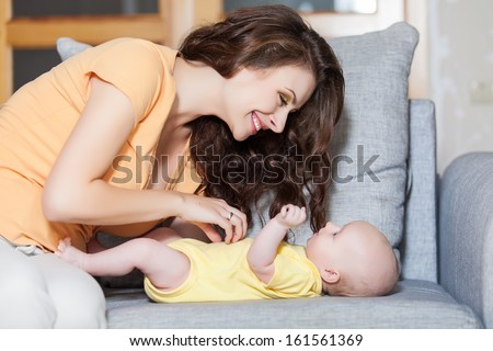 mother with her cute baby - stock photo