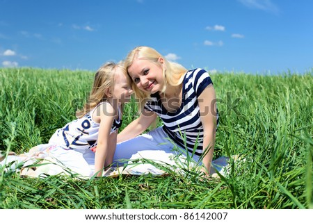 mother with her daughter outdoors in summer day - stock photo