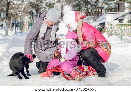 mother with her daughters and a dog - stock photo
