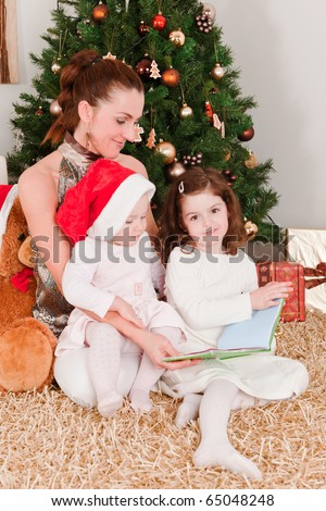 Mother with her daughters at Christmas - stock photo