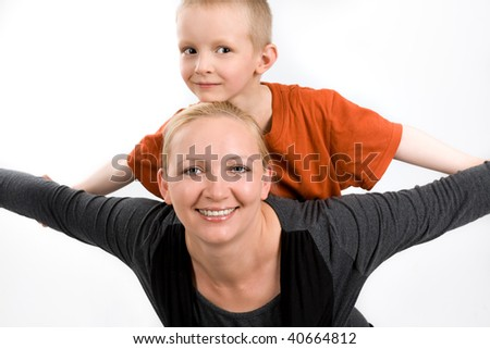 Mother with her five years old son, on a white background