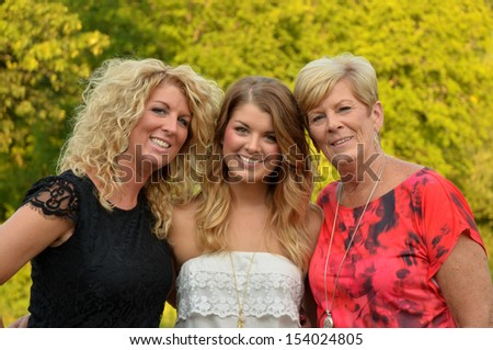 mother with her grown daughter and granddaughter - stock photo