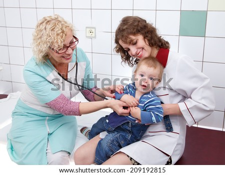 Mother with her little son on doctor examination  - stock photo