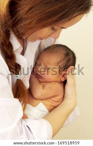 mother with her newborn baby - stock photo