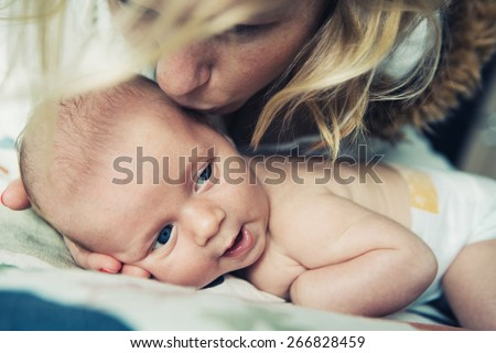Mother with her newborn baby  family love care - stock photo