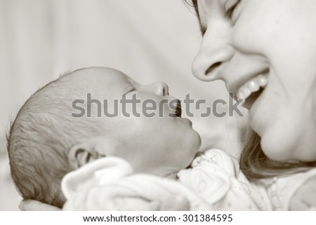 Mother with her newborn baby, sepia, close up - stock photo