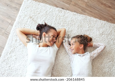 Mother with her preteen daughter at home - stock photo