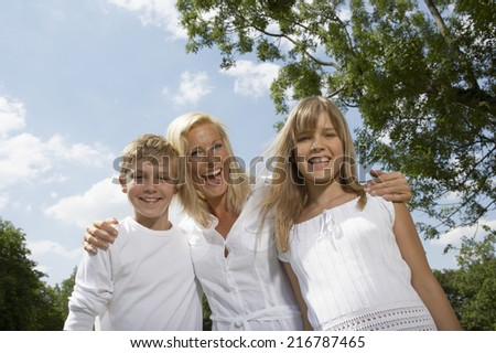 Mother with her son and daughter. - stock photo