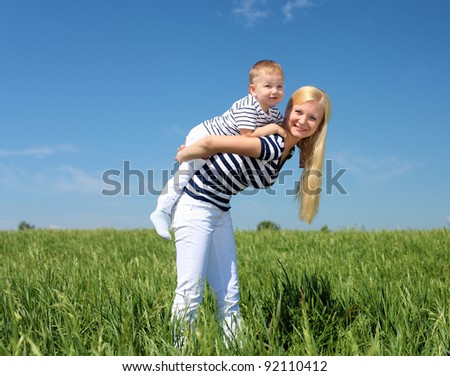 mother with her son outdoor in sunny summer day