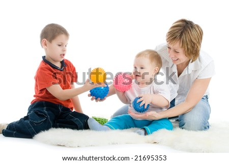 Mother with her sons enjoy with colorful balls over white background - stock photo
