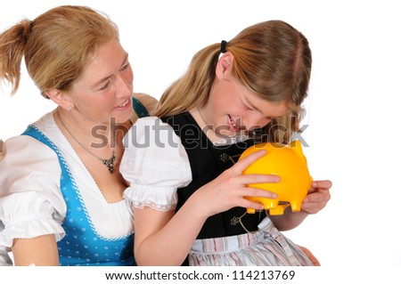 Mother with her two children and piggy bank - stock photo