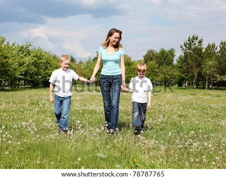 mother with her two sons outdoors together