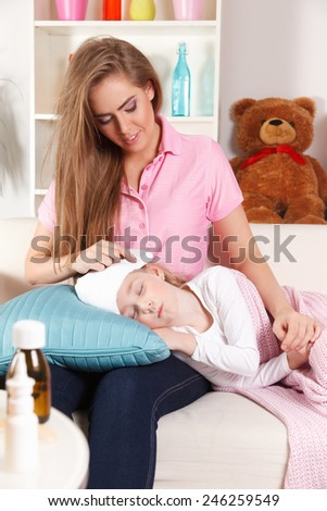 Mother with ill child - stock photo