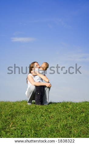Mother with kid. Sky. Grass. 4 - stock photo